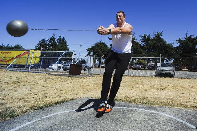 Hammer thrower Mike Mai practices at Fort Lewis, July 1. Mai finished third at the U.S. National Championships and will soon compete at the World Track and Field Championships in Berlin, Germany. Image credits : Phil Sussman.