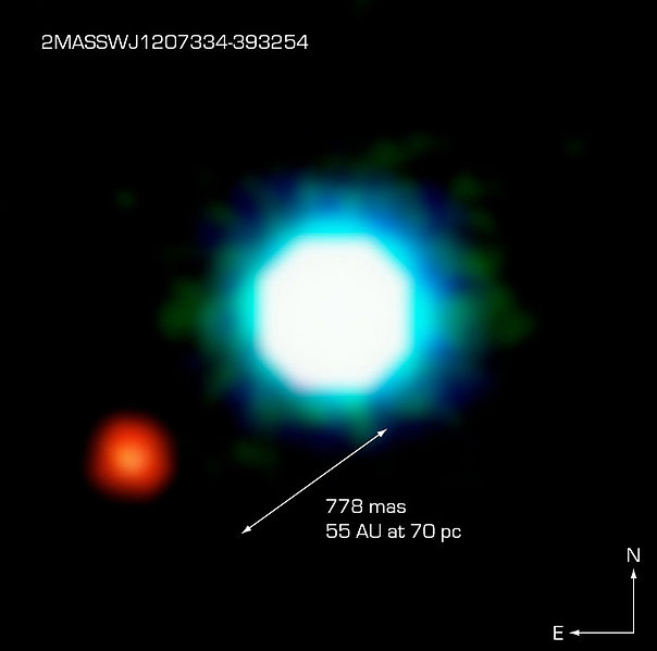 The NACO image of an exoplanet (red dot) close to a very low, cool mass star. Possibly the first image of an exoplanet ever. Credits: ESO
